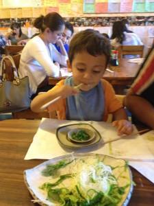 child eating seaweed salad